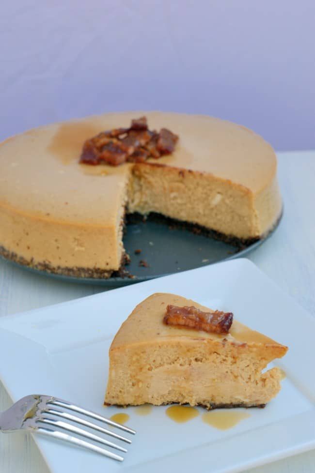 A slice of bacon maple cheesecake on a white plate