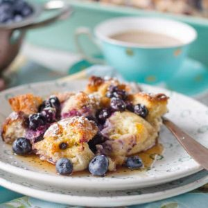 Blueberry french toast casserole on two white plates
