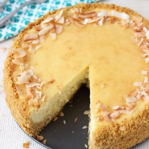 Pina colada cheesecake with a slice taken out