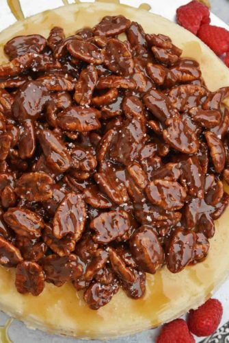 Pecan Pie Cheesecake is the perfect combination of two classic desserts - chocolate pecan pie and cheesecake. You'll want this on your holiday dessert menu! #chocolatepecanpie #pecanpiecheesecake #bestcheesecakerecipe www.savoryexperiments.com
