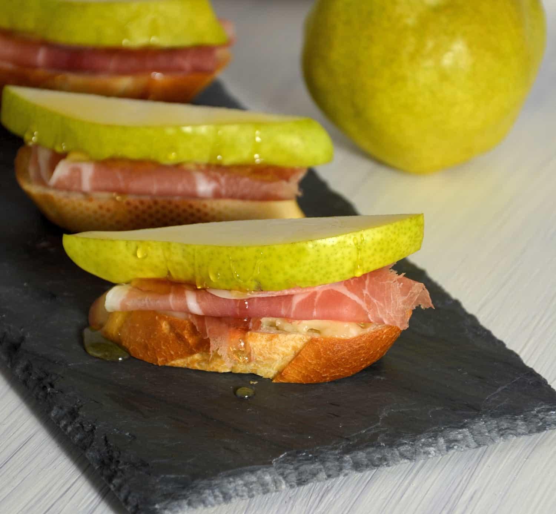 Pear and brie crostinis on black slate