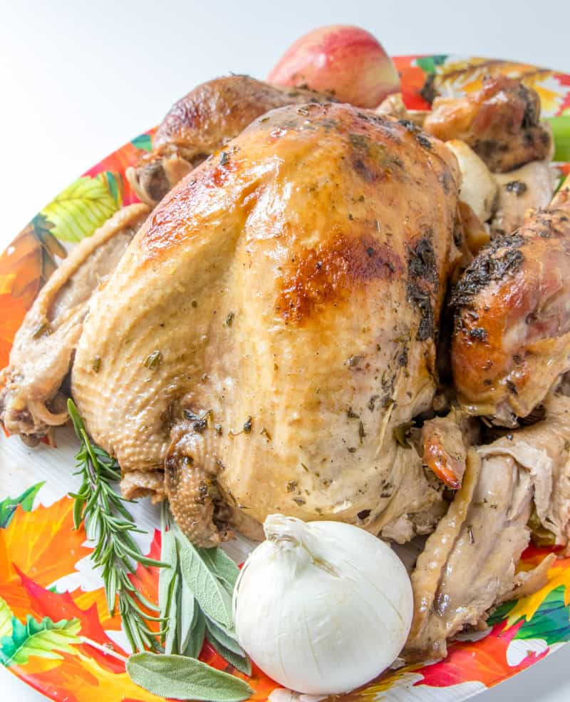 Juicy Roasted Turkey is easier than you think with my buttery recipe, a bottle of bubbles and fresh herbs. The best juicy turkey recipe ever! #juicyroastedturkey #bestturkeyrecipe #thanksgivingturkey www.savoryexperiments.com