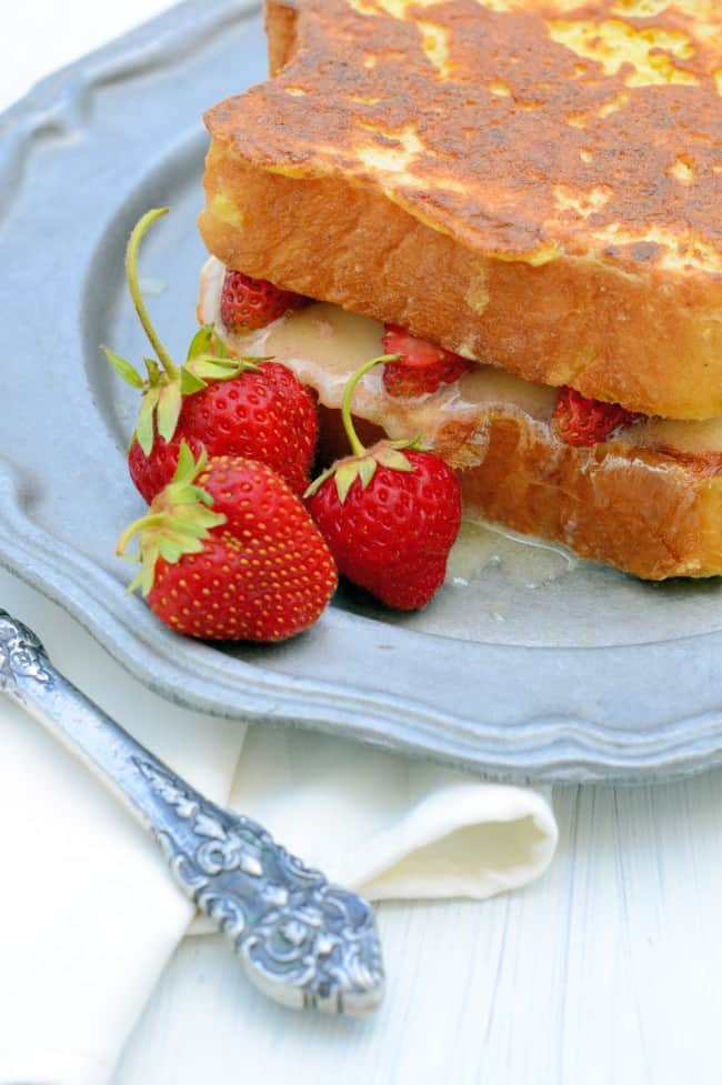 Strawberry french toast on a plate with strawberries