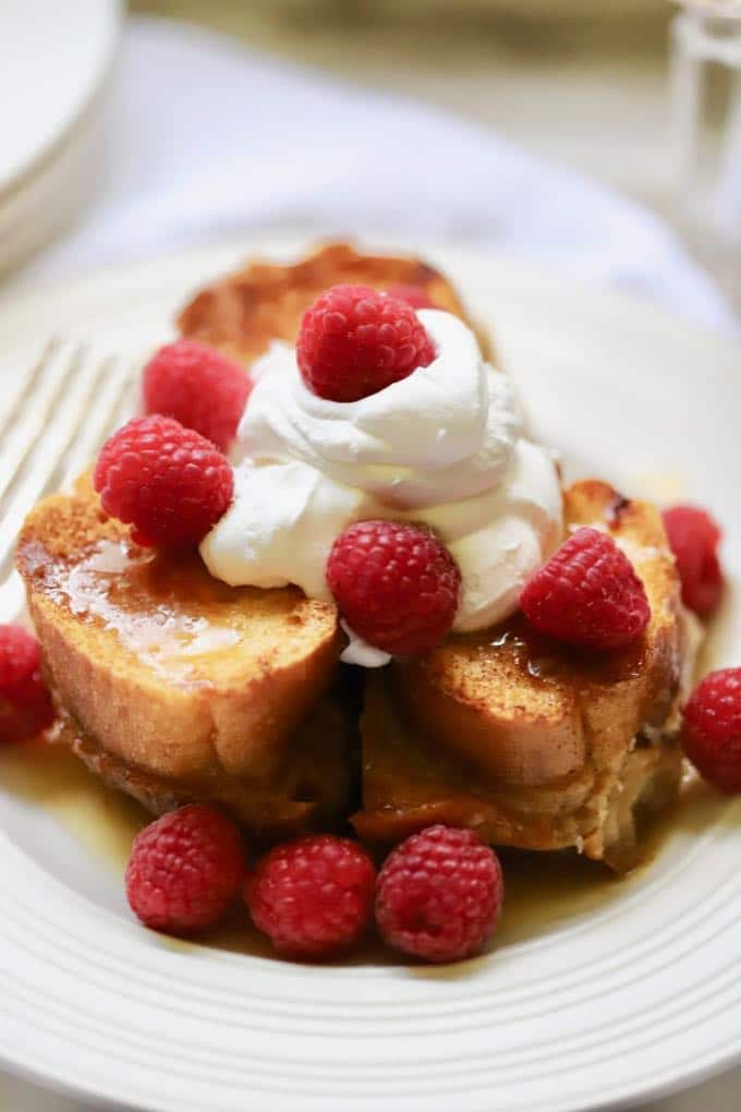 Caramel soaked french toast topped with raspberries