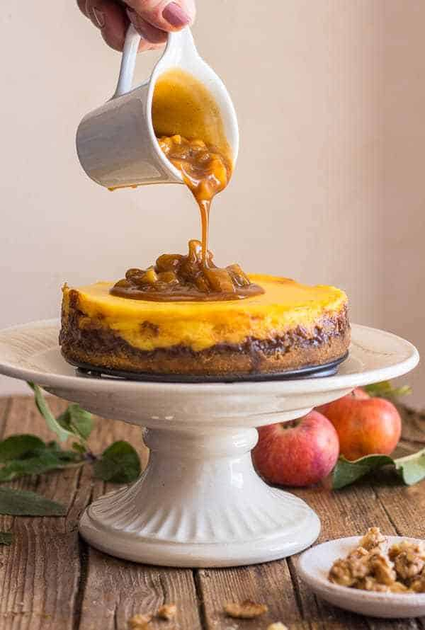 Maple caramel apple cheesecake on a pedestal