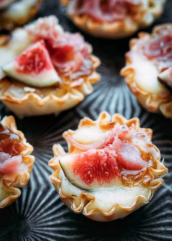 Baked brie bites with fig on a tray