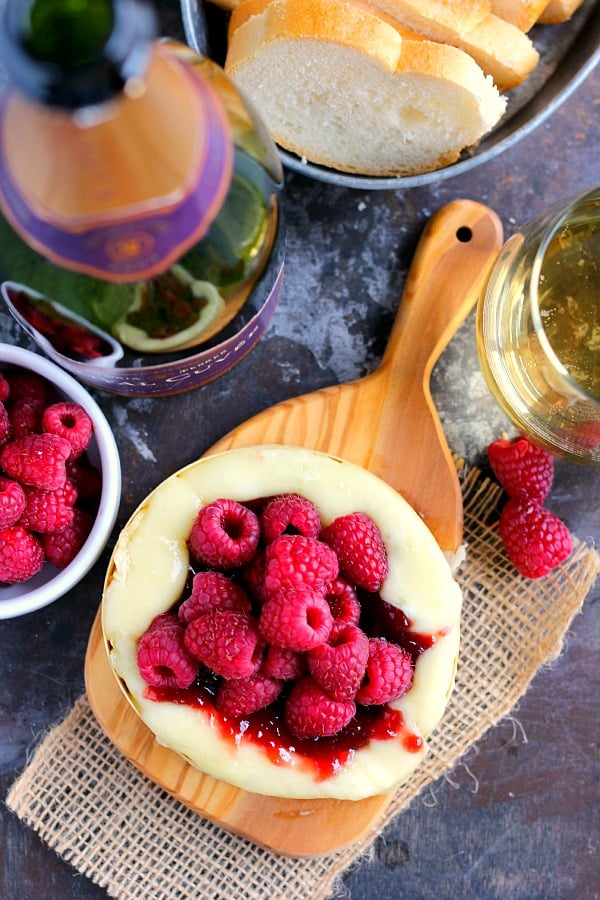 Raspberry baked brie on a wooden board