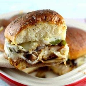 Close up of philly chicken sliders on a wooden spoon