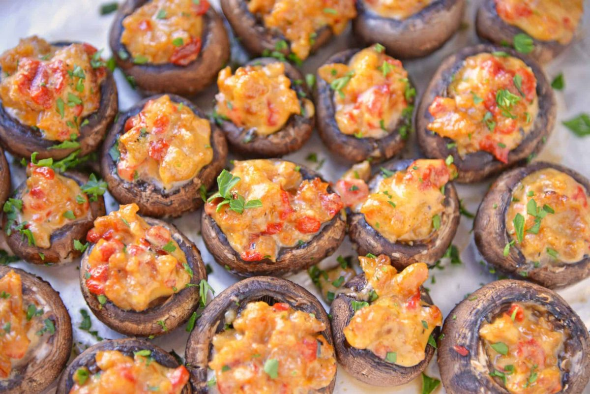 cluster of sausage stuffed mushrooms with red peppers and parsley