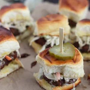 Barbecue bacon meatball slider topped with a pickle