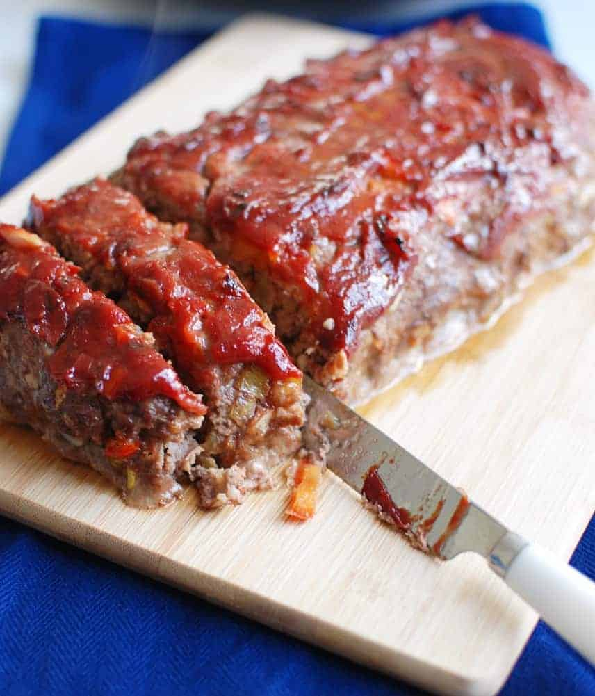 Green chile meatloaf on a cutting board
