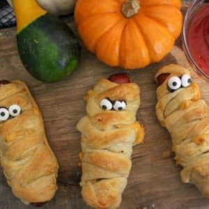 Spooky snacks for Halloween on a cutting board