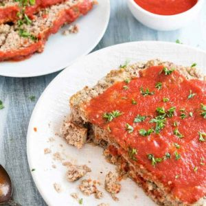Instant pot meatloaf on a white plate