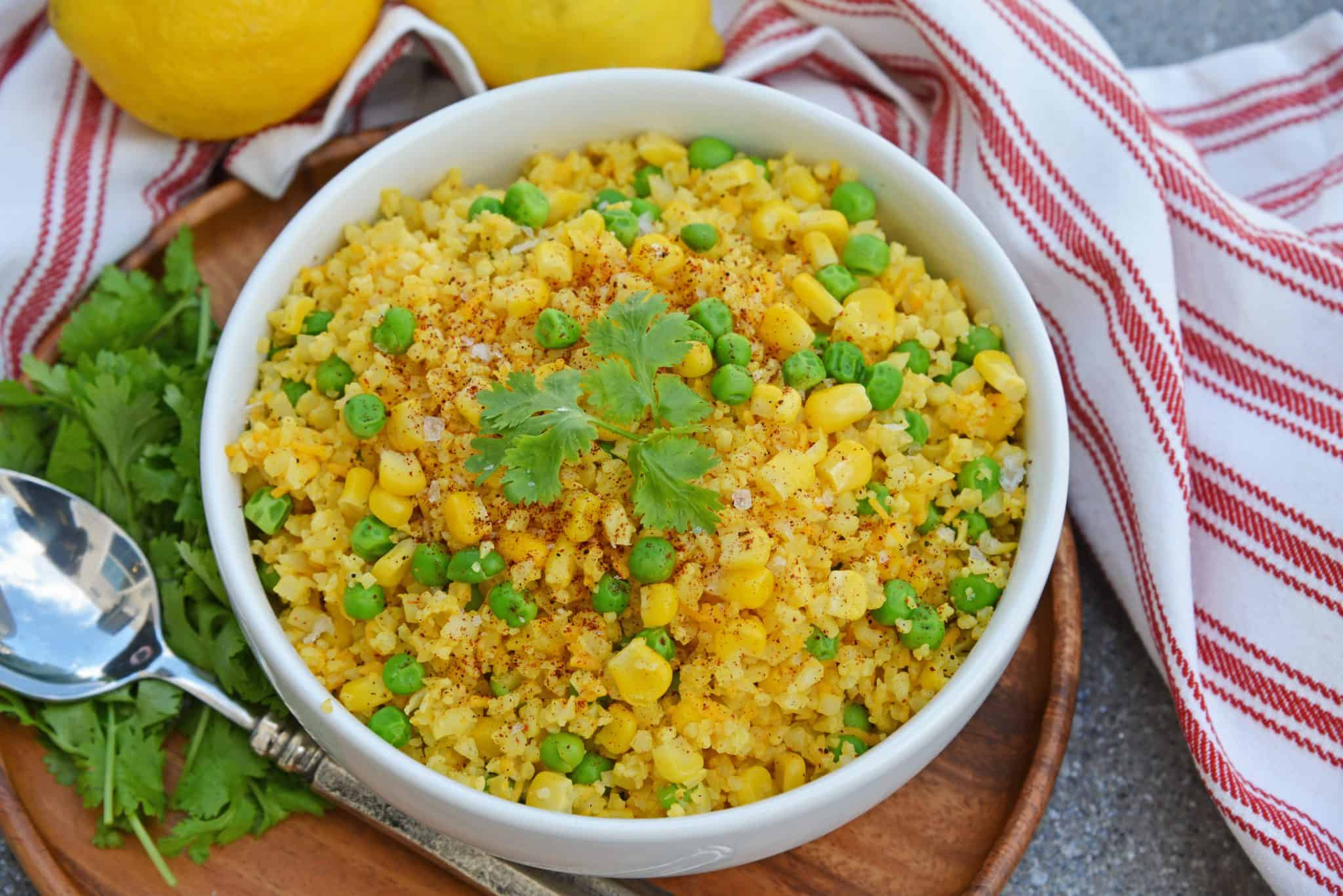 This Mexican Cauliflower Rice recipe is a deliciously easy and cheesy cauliflower rice made with simple ingredients and lots of flavor. #cheesycauliflowerrice #cauliflowerricerecipe #mexicancauliflowerrice www.savoryexperiments.com