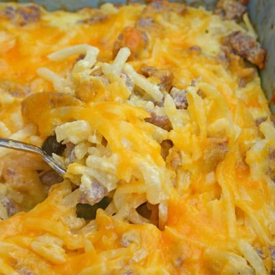 Sausage Hash Brown Breakfast Casserole is one of the best breakfast casserole recipes for a special brunch or breakfast. Easy, cheesy and delicious! #breakfastcasserolerecipes #sausagehashbrownbreakfastcasserole www.savoryexperiments.com