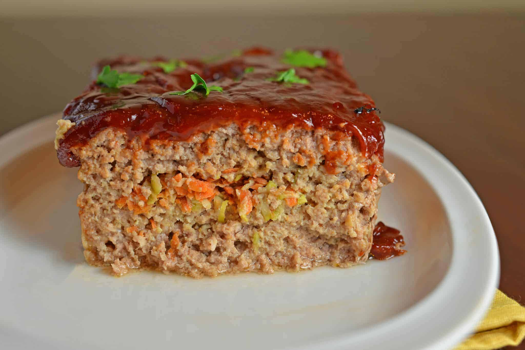 Stuffed meatloaf on a white plate