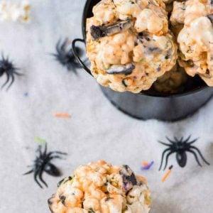 Halloween popcorn balls in a black bowl