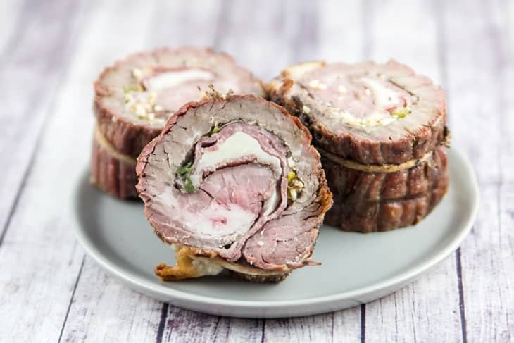 Italian flank steak pinwheel recipes on a white plate