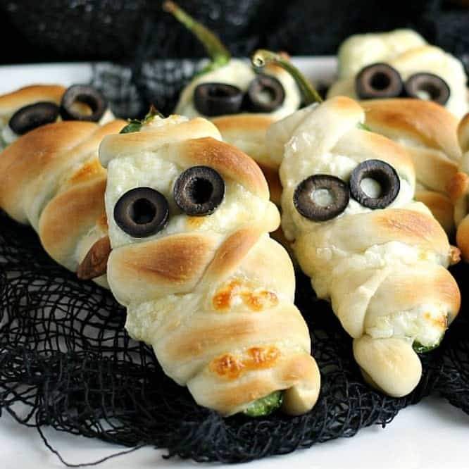 Jalapeno popper mummies on black burlap