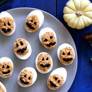Jack-O-Lantern Deviled Eggs on a tray