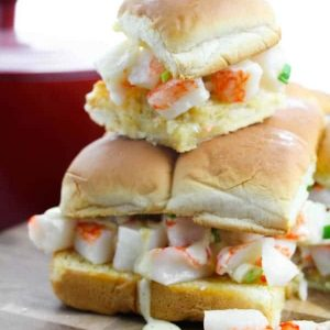 A stack of lobster sliders on a cutting board