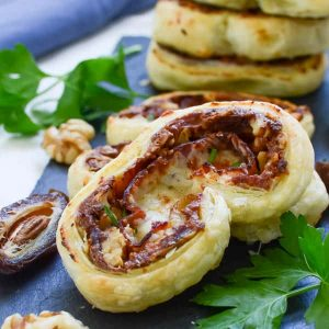 Prosciutto and date pinwheel recipes on top of greens