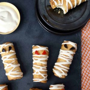 Cute Snacks for Halloween as pizza roll up mummies