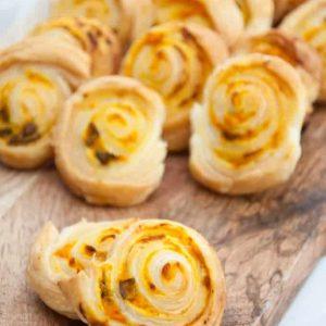 Pumpkin basil pinwheel recipes on a cutting board