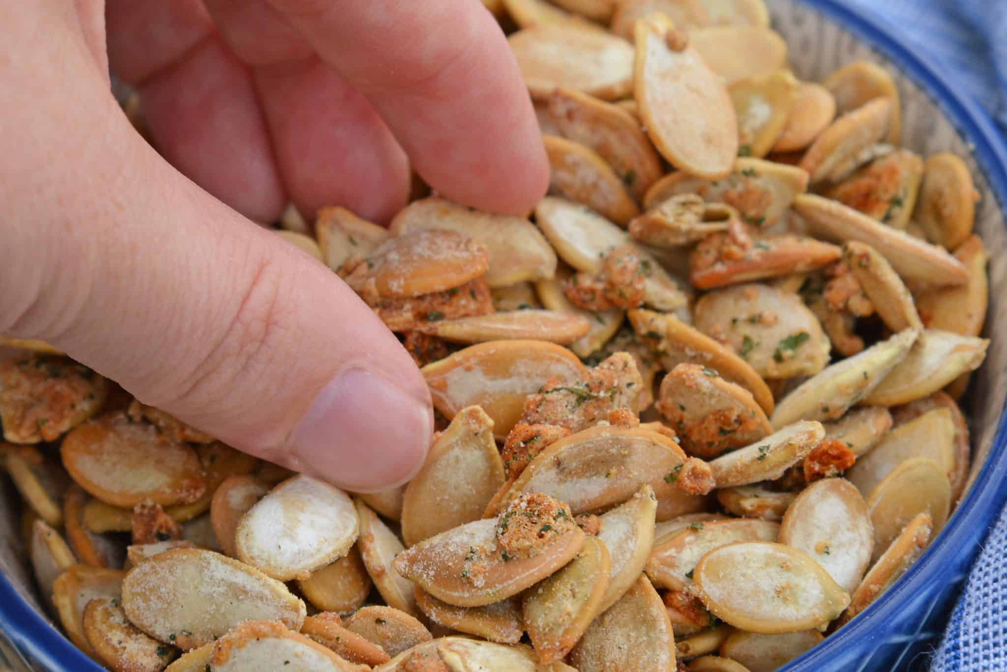 Ranch Pumpkin Seeds take roasted pumpkin seeds to a whole new level. With only 3 ingredients, they're an easy and delicious fall snack! #roastedpumpkinseeds #ranchpumpkinseeds www.savoryexperiments.com
