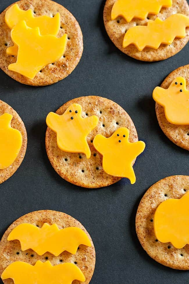 Ghost cheese on crackers as snacks for Halloween