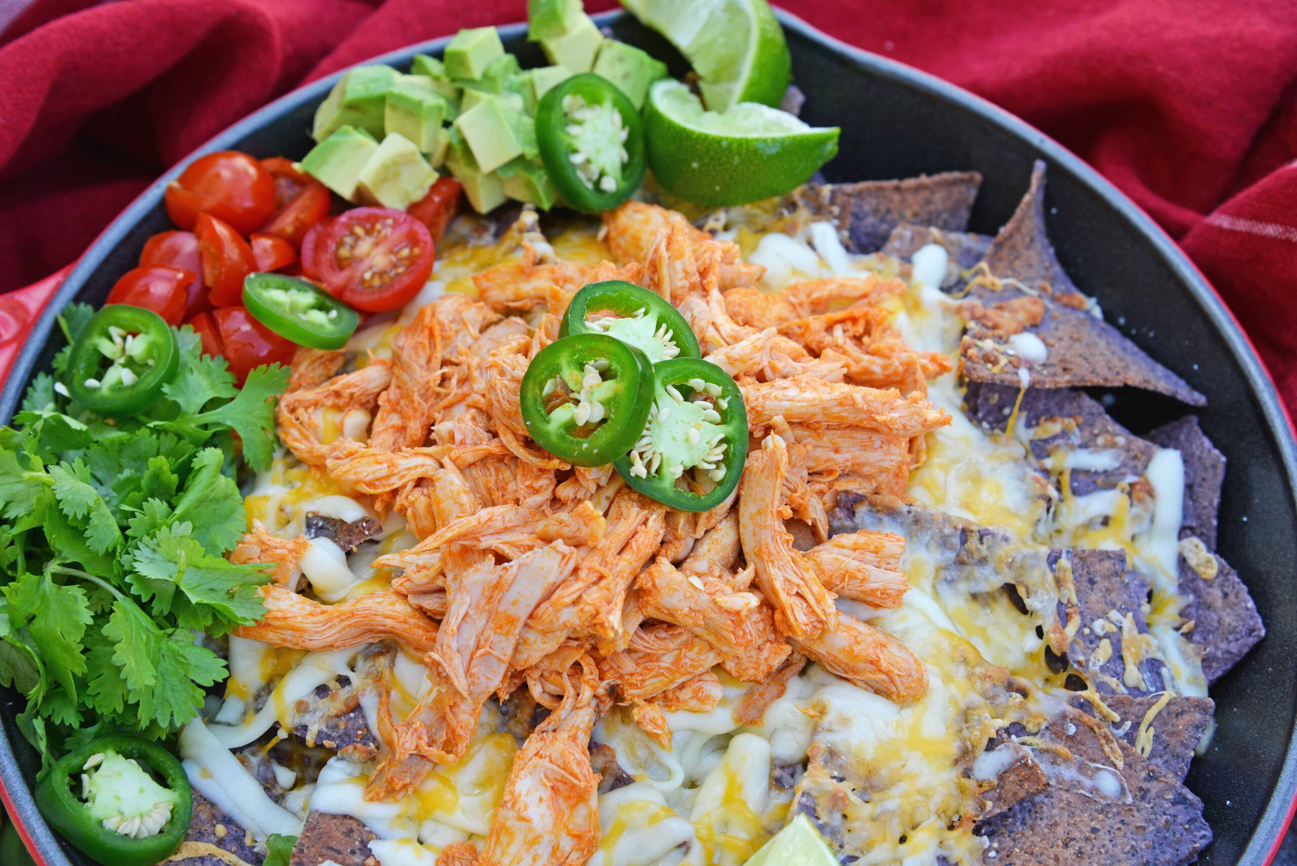 Buffalo Chicken Nachos is an easy nachos recipe that is perfect for a quick Tex Mex meal or game day appetizer. Ready in minutes with few ingredients! #buffalochickennachos #buffalochicken #nachosrecipe www.savoryexperiments.com