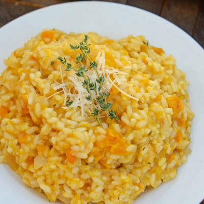 Butternut Squash Risotto is an easy side dish or entrée made with Arborio rice, crisp white cooking wine, sweet roasted butternut squash and fresh thyme. #risottorecipes #butternutsquash www.savoryexperiments.com