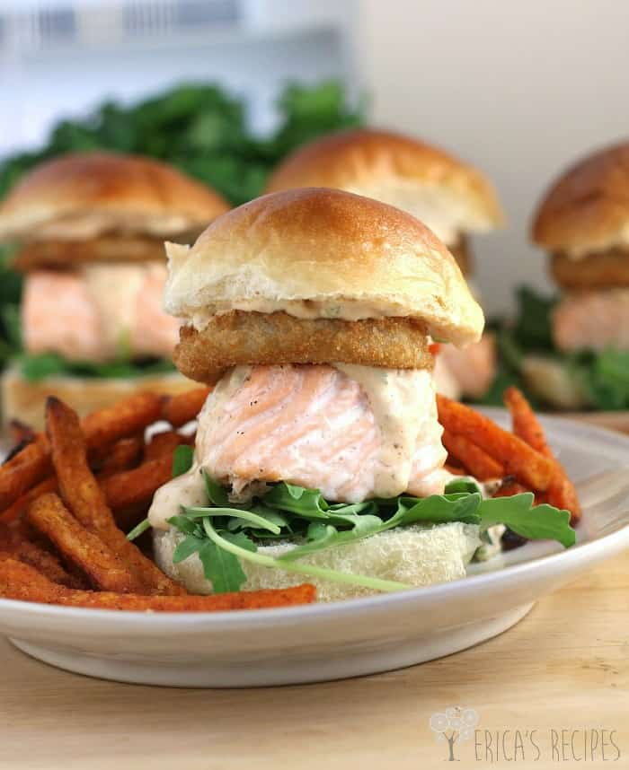 Cajun salmon slider sandwich recipes on a white plate with sweet potato fries