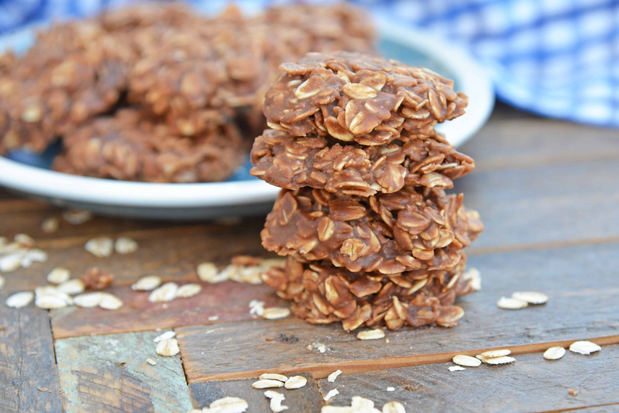 Classic no bake cookies stacked in front of a plate