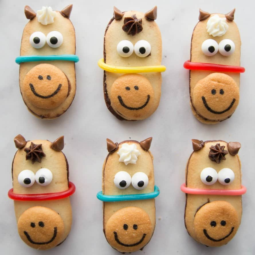 No bake horse cookies lined up on a tray