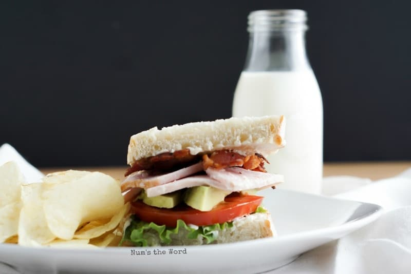 Turkey BLT on a white plate - leftover turkey recipes