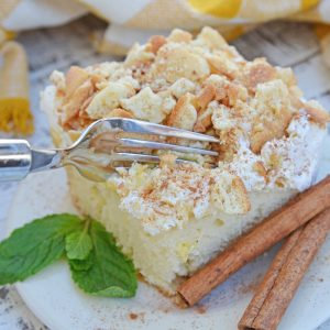 This Eggnog Poke Cake recipe is an easy pudding poke cake made with box cake mix and instant vanilla pudding, with delicious eggnog flavor. #pokecakerecipe #puddingpokecake #eggnogrecipes www.savoryexperiments.com