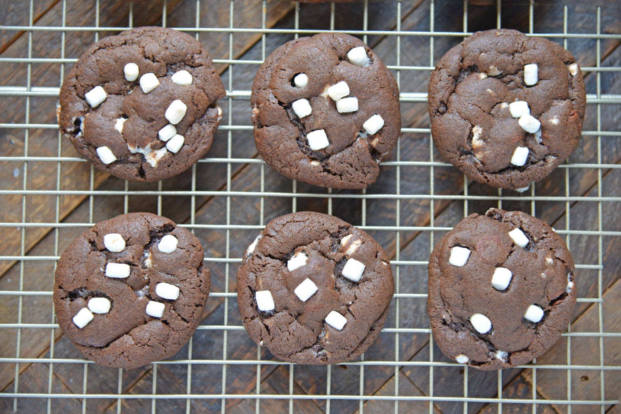 Hot Chocolate Cookies are must-make Christmas cookies! A favorite chocolate sugar cookie recipe with marshmallows, you'll never be able to eat just one! #hotchocolatecookies #chocolatesugarcookiesrecipe #christmascookies www.savoryexperiments.com