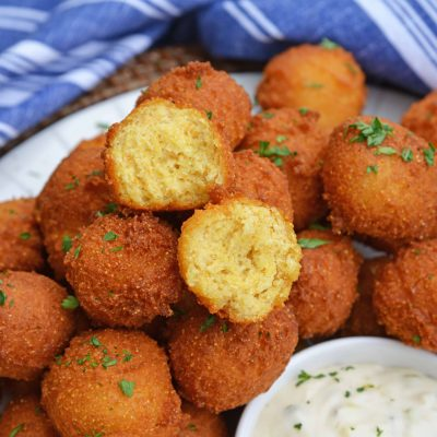 Hush Puppies are gently fried cornbread with a crunchy outside and soft, doughy inside. Serve with fish fry, fried shrimp or any BBQ! #hushpuppyrecipe www.savoryexperiments.com