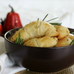 Thanksgiving sides rosemary crescent rolls in a black bowl