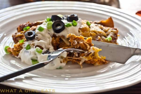 Turkey enchiladas on a white plate - leftover turkey recipes