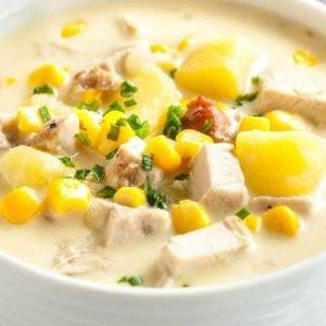 Turkey corn chowder in a white bowl - leftover turkey recipes