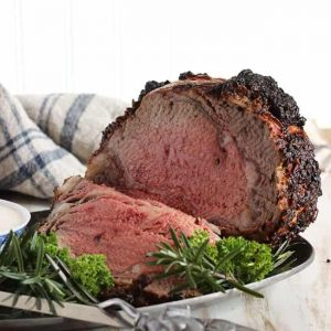 Standing rib roast sliced on a tray - Christmas main dishes