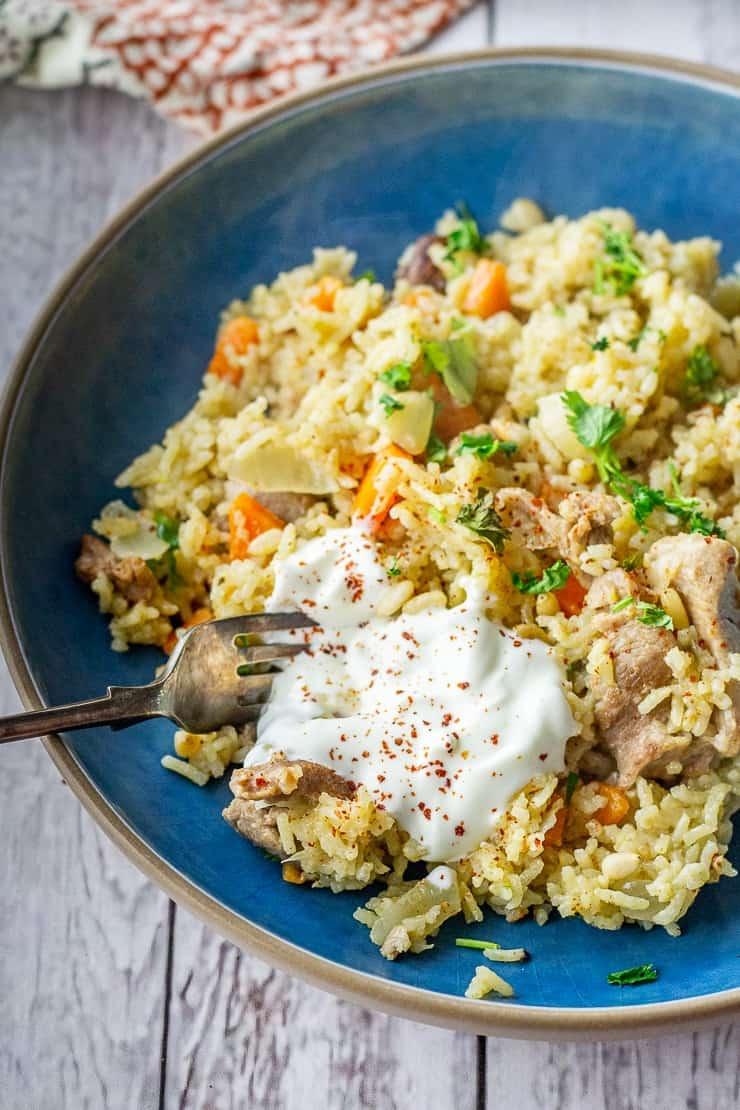 Turkey pilaf in a blue bowl - leftover turkey recipes