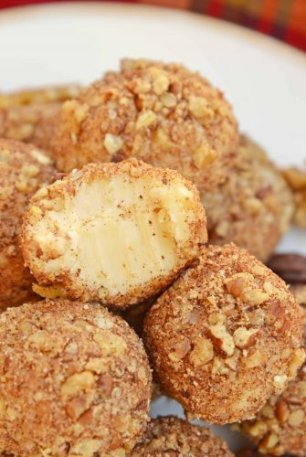 White Chocolate Truffles are an easy truffle recipe made with just a handful of ingredients. Creamy white chocolate rolled in toasted pecans, cinnamon and nutmeg.#whitechocolatetruffles #easytrufflerecipe www.savoryexperiments.com