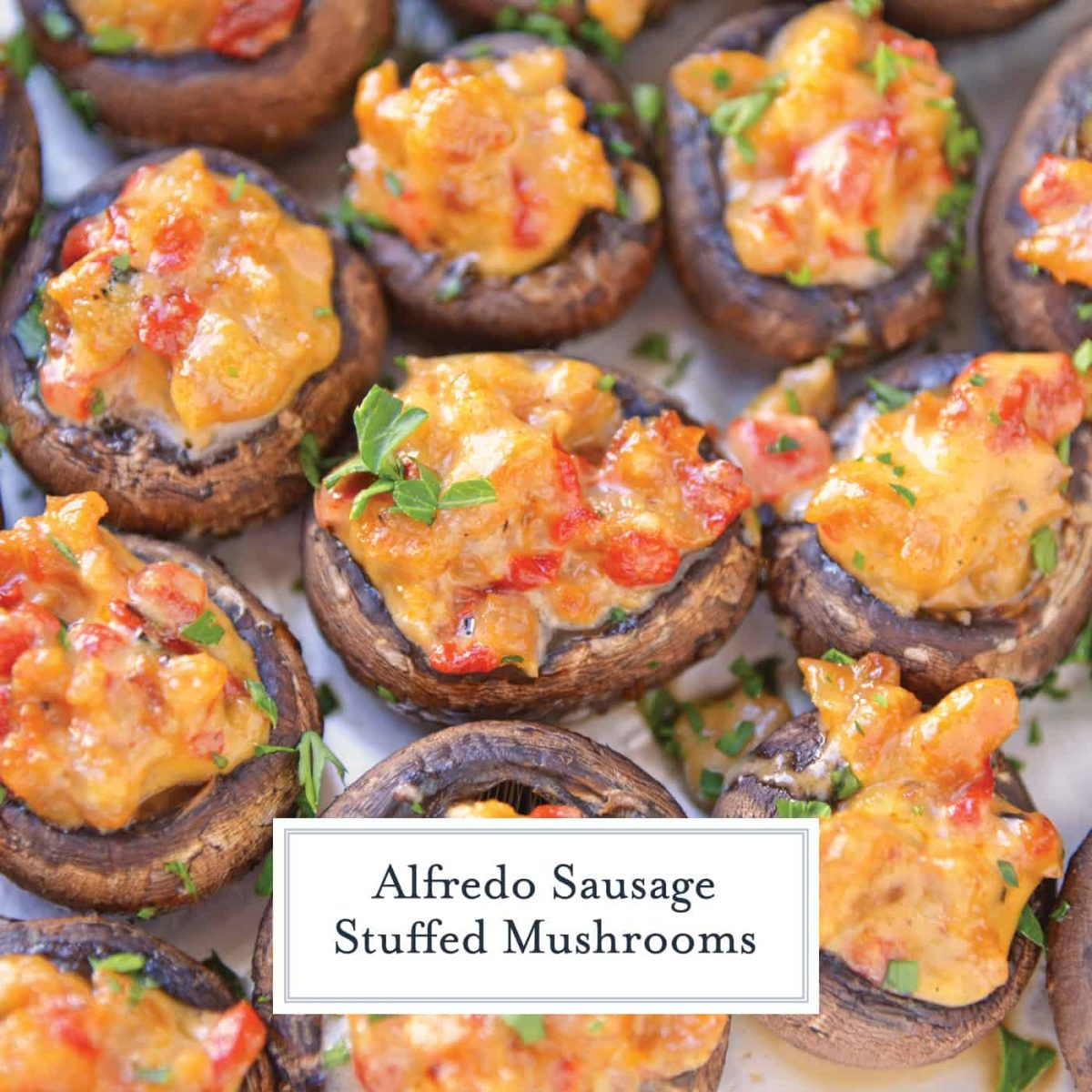 Alfredo Sausage Stuffed Mushrooms are an easy appetizer that's perfect for holiday parties. Everyone will love these stuffed mushrooms with sausage! #sausagestuffedmushrooms #stuffedmushrooms www.savoryexperiments.com