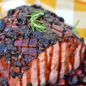 Balsamic Cherry Ham Glaze is an easy ham glaze for your Christmas ham or any baked ham throughout the year. Tart cherries, balsamic vinegar and brown sugar lend bold flavors. #hamglaze #christmasham #hamrecipe www.savoryexperiments.com