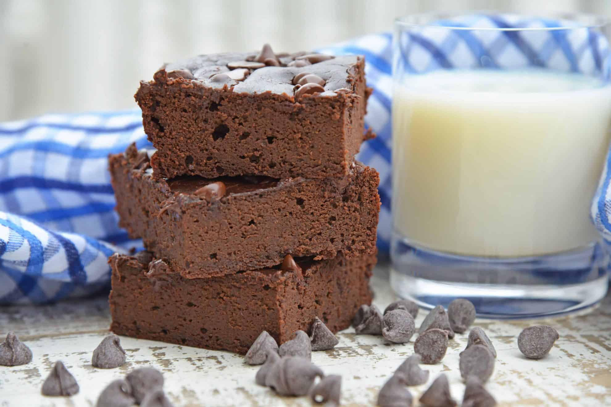 Flourless Black Bean Brownies are a delicious, fudgy gluten free brownie recipe. Healthy brownie recipes have never tasted this good! #glutenfreebrownies #homemadebrownies #flourlessbrownies #blackbeanbrownies www.savoryexperiments.com