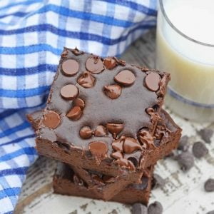Stack of Flourless Black Bean Brownies with a glass of milk