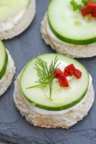 These Cucumber Sandwiches, or cucumber canapes, are easy tea sandwiches that are perfect for any get-together, including holiday parties. #cucumbersandwiches #cucumbercanapes #teasandwiches www.savoryexperiments.com